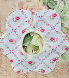 Flower shaped baby bib. trellis rose.