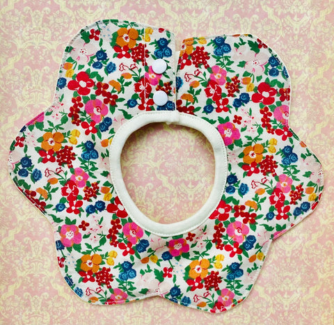 Flower shaped baby bib. Vintage bright floral