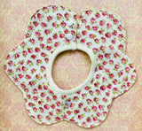 Flower shaped baby bib. Bright rosebud.