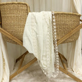 cream cotton and lace baby swaddle.