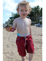 Kid on beach with bar
