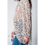 Oversized floaty cream blouse with flower print and tassels