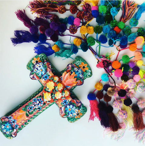 cross and pompoms