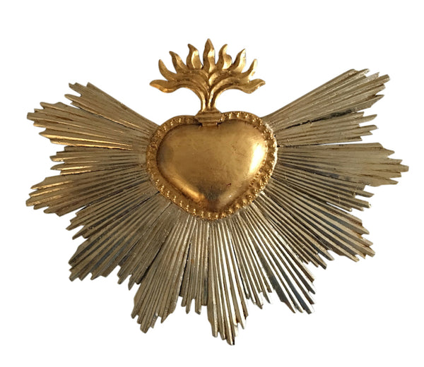 gold leaf heart with sun rays and flames