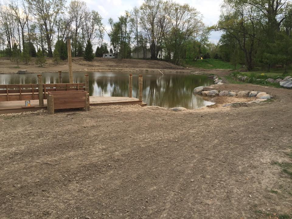BATH, MICHIGAN.  Pond Cleanout w/ Boulder Walls & Dock