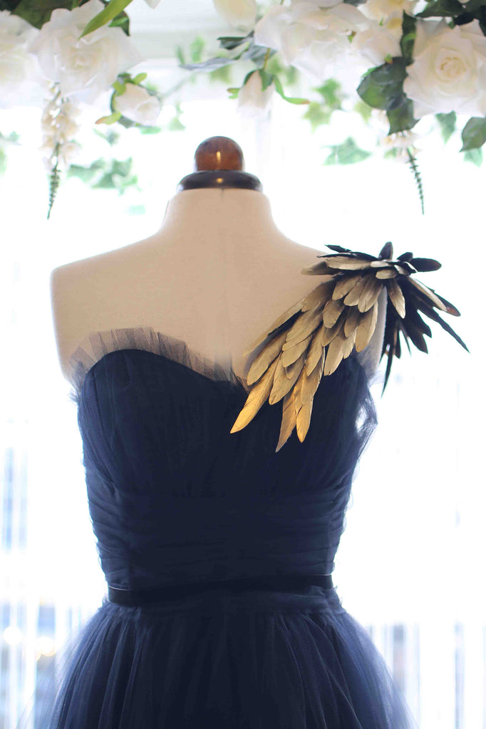 black and gold feather ballgown by Alexandra King