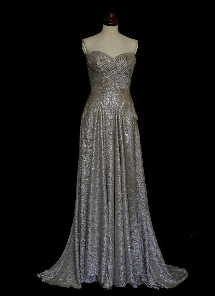 Gold strapless gown in metallic lurex by Alexandra King. Titled the snake charmer, suitable for the red carpet or as a wedding bridal dress. One of a kind hand made in the UK