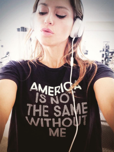 Famous singer Lola Ponce wearing fashion statement tshirt America Is Not The Same Without Me