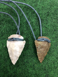 Handmade stone arrowhead on leather cord