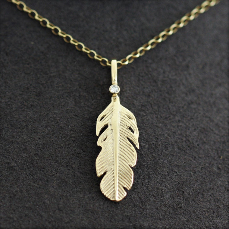 Diamond and solid gold feather necklace