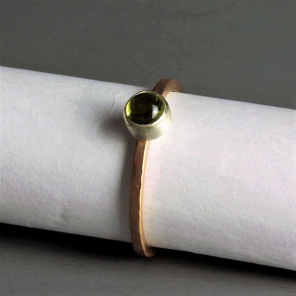 designer silver and gold peridot gemstone ring