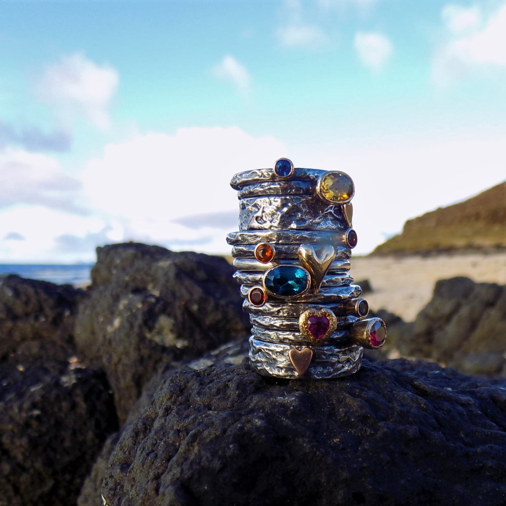 Stacking Treasure rings with different shaped Gemstones in Gold
