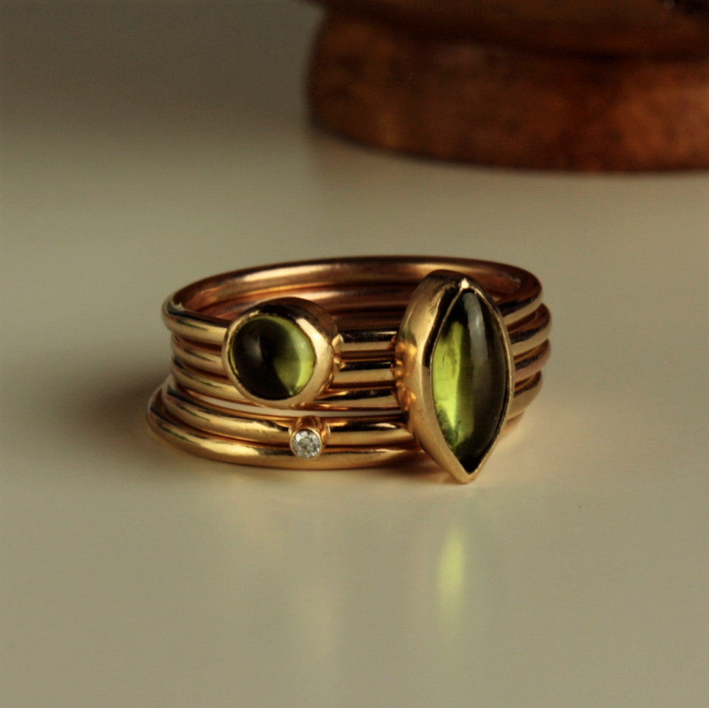 handmade solid gold peridot gemstone and diamond stacking rings for August birthstone