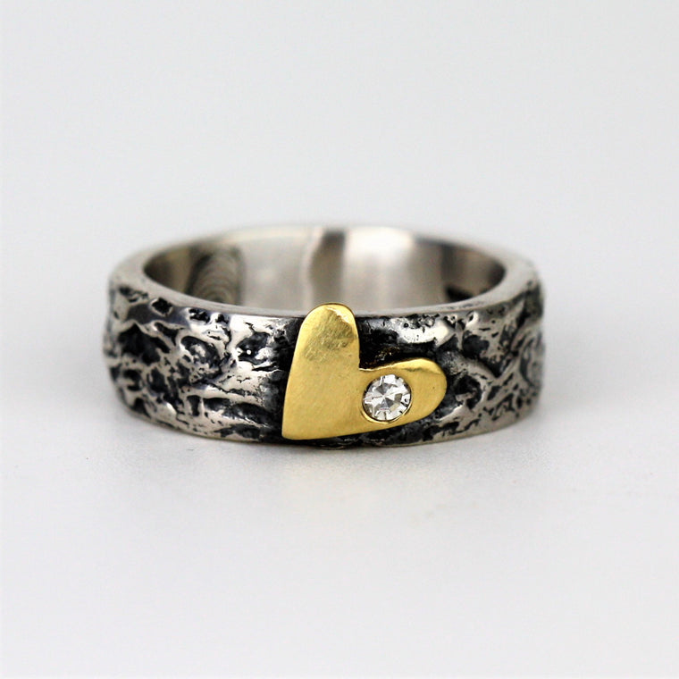 Diamond and gold heart textured mixed metals ring band