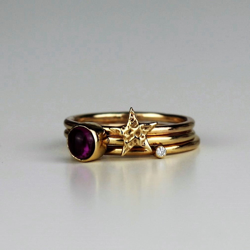 Diamond textured gold star and tourmaline midi stacking rings