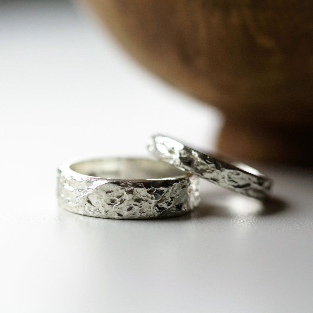 Matching textured sterling silver wide treasure island wedding rings