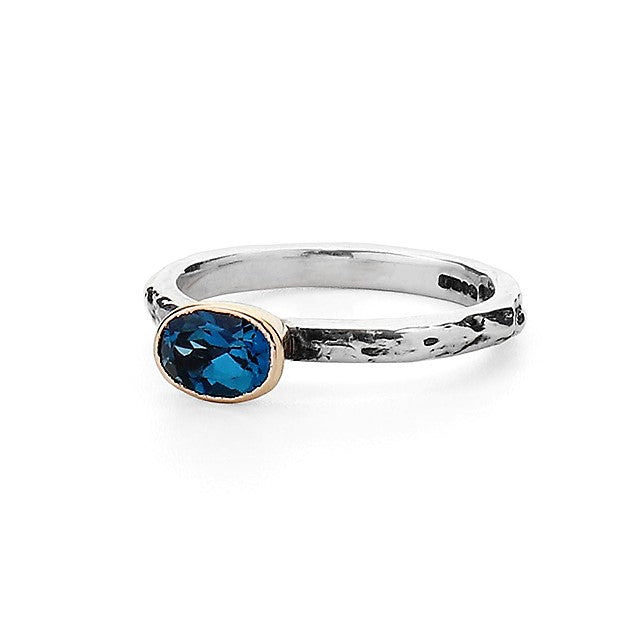 Oval Blue Topaz set in 9ct gold on a Silver Textured Ring Band
