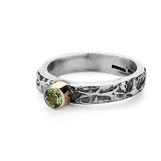 Peridot round green gemstone on a oxidized silver and gold ring