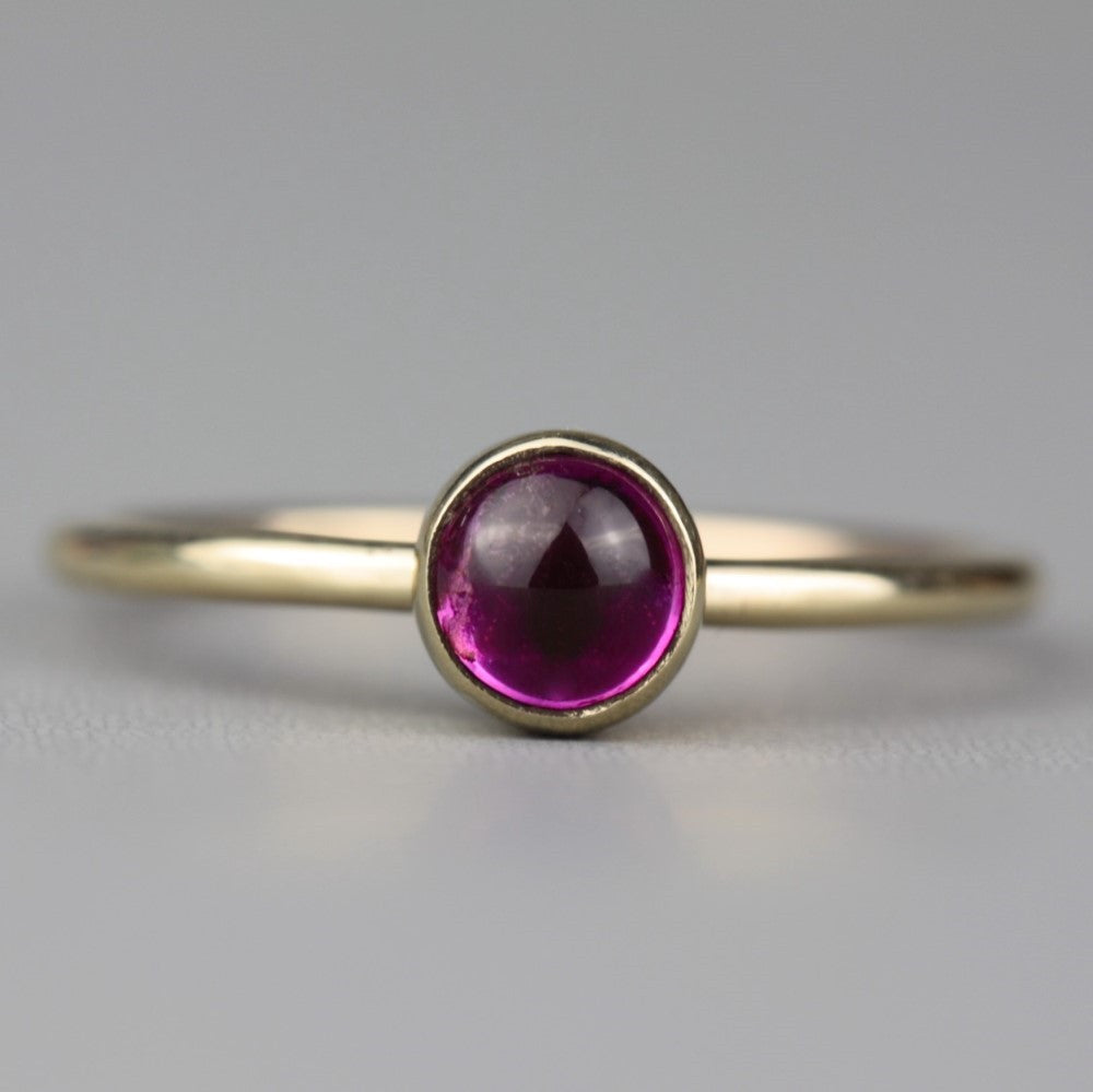 Solid gold stackable ring featuring a stunning pink Tourmaline cabochon gemstone