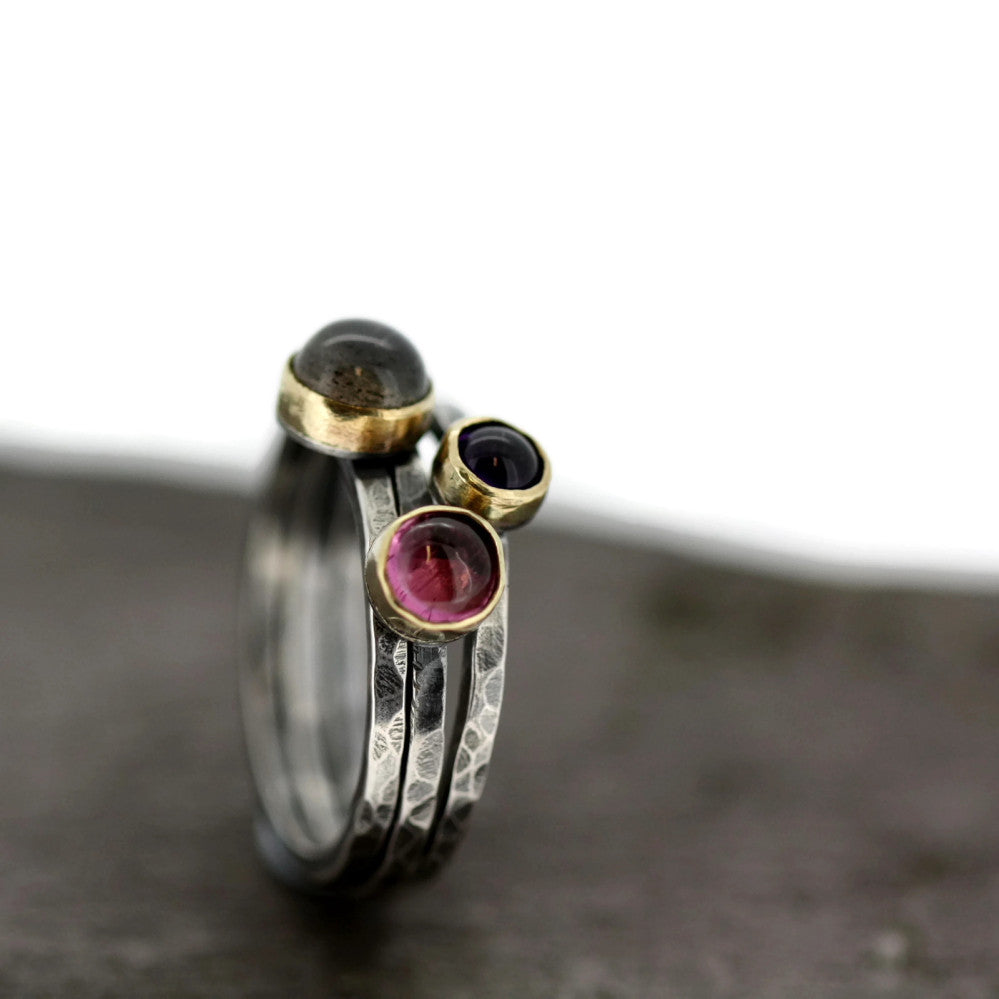 a dreamy set of silver and gold mixed metal blossom rings