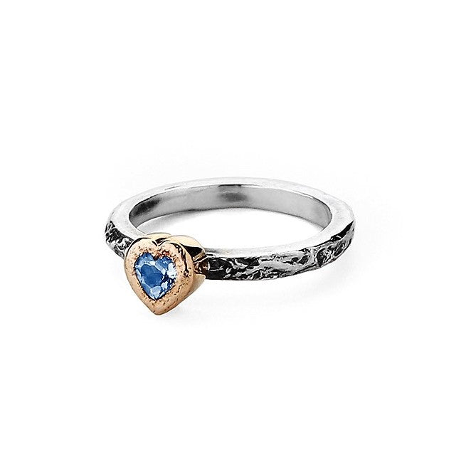 Moonstone heart encased in 9ct gold setting on a textured silver ring