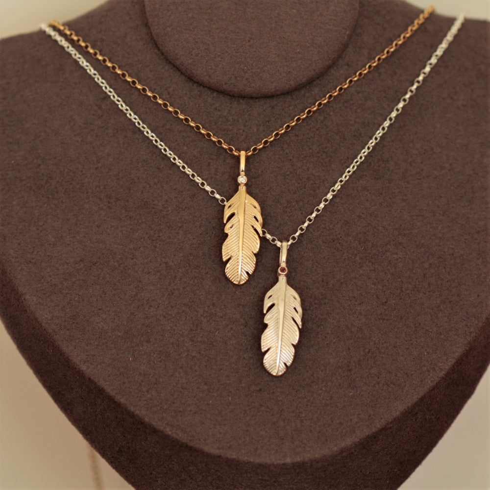 gold and silver gemstone angel feather necklace