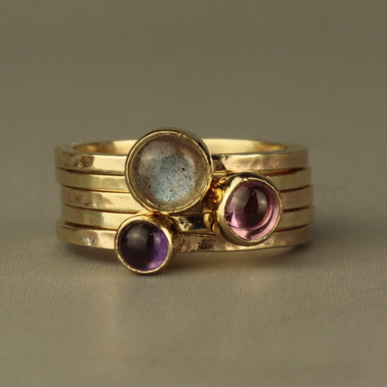 designer solid gold blossom stacking rings featuring Amethyst, Labradorite and Pink Tourmaline cabochon gemstones