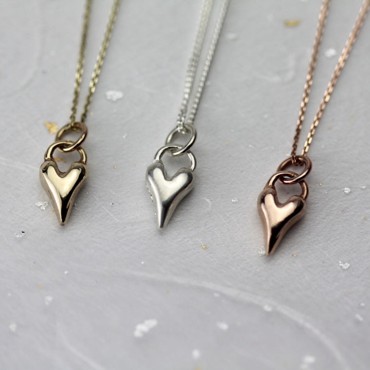 A selection of gold and silver wild at heart dainty necklace