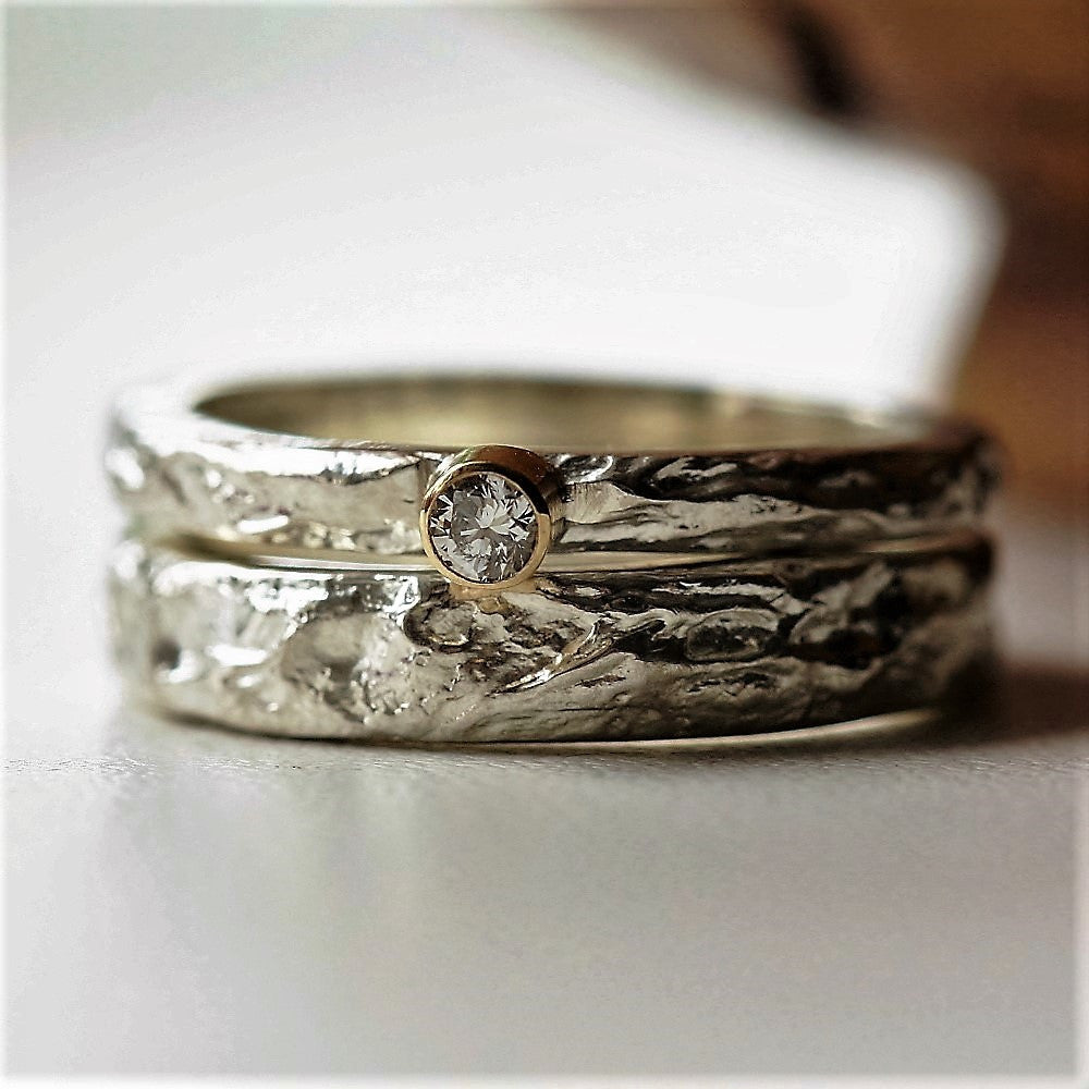 Silver textured treasure ring with a matching diamond treasure ring