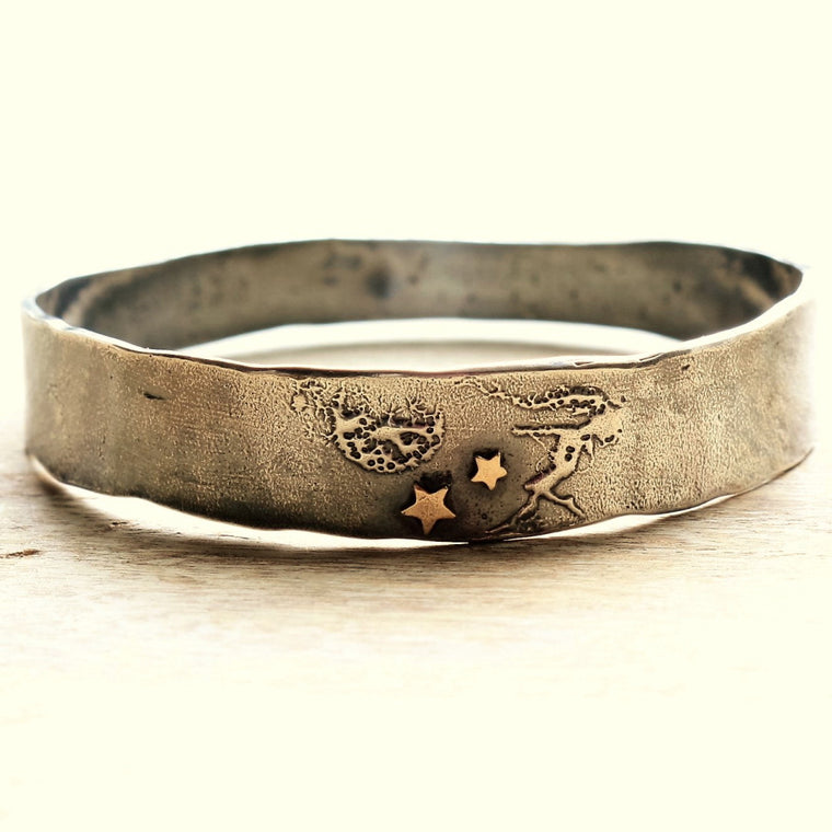 whimsical designer bangle with a fairy design and solid 9ct gold stars