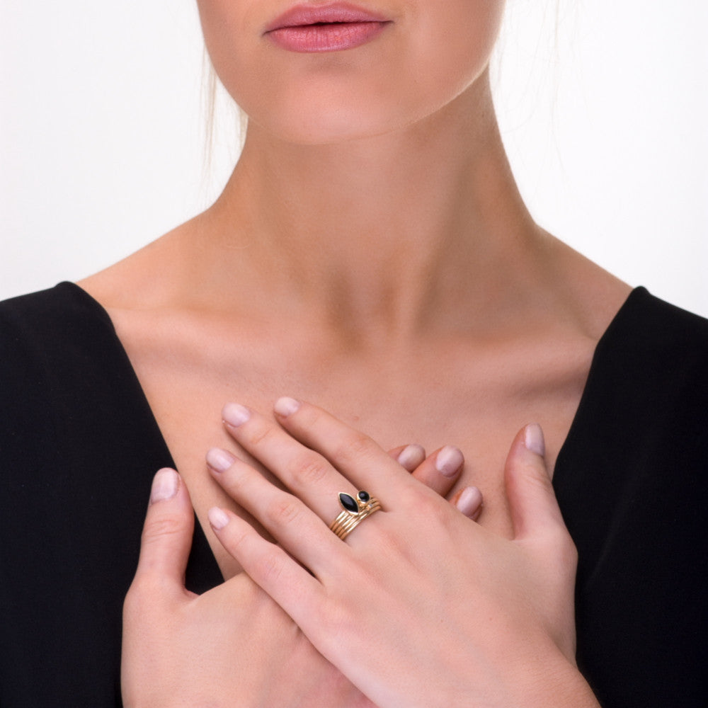 Model wearing marquise black onyx and diamond solid 9ct gold stacking rings