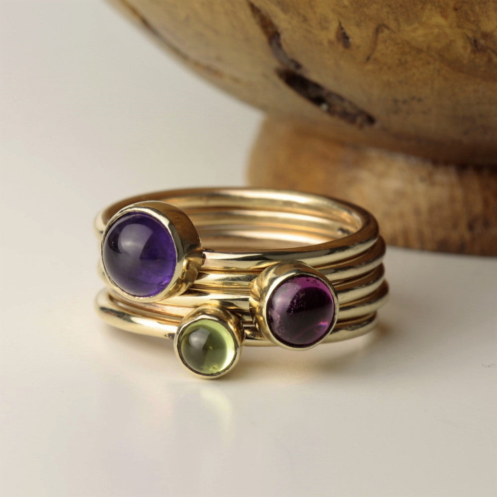 Get the Wild Flower stacking look with this Amethyst Pink Tourmaline and Peridot gold stacking ring