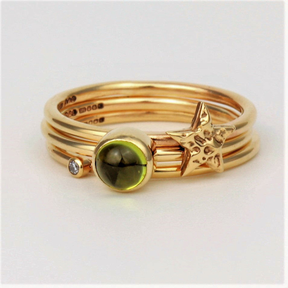 Universe gold stacking rings in Peridot gemstone