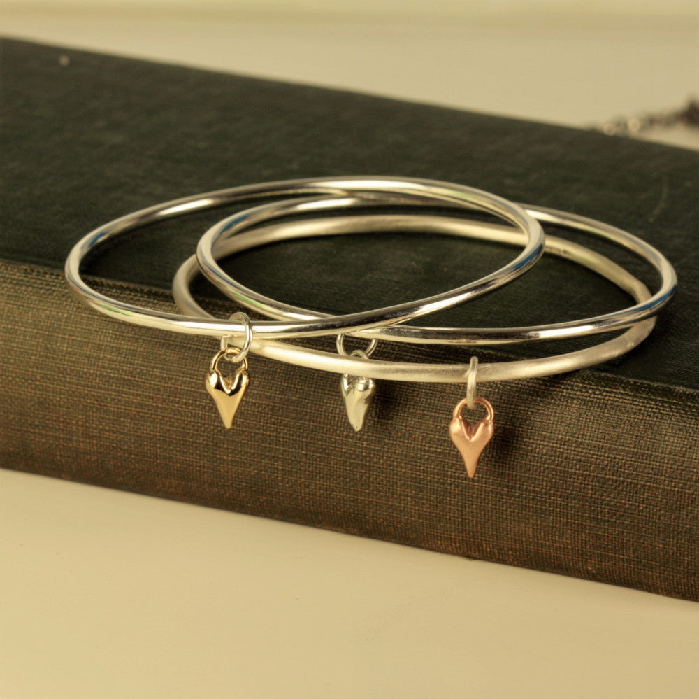 Handmade silver and gold heart bangles