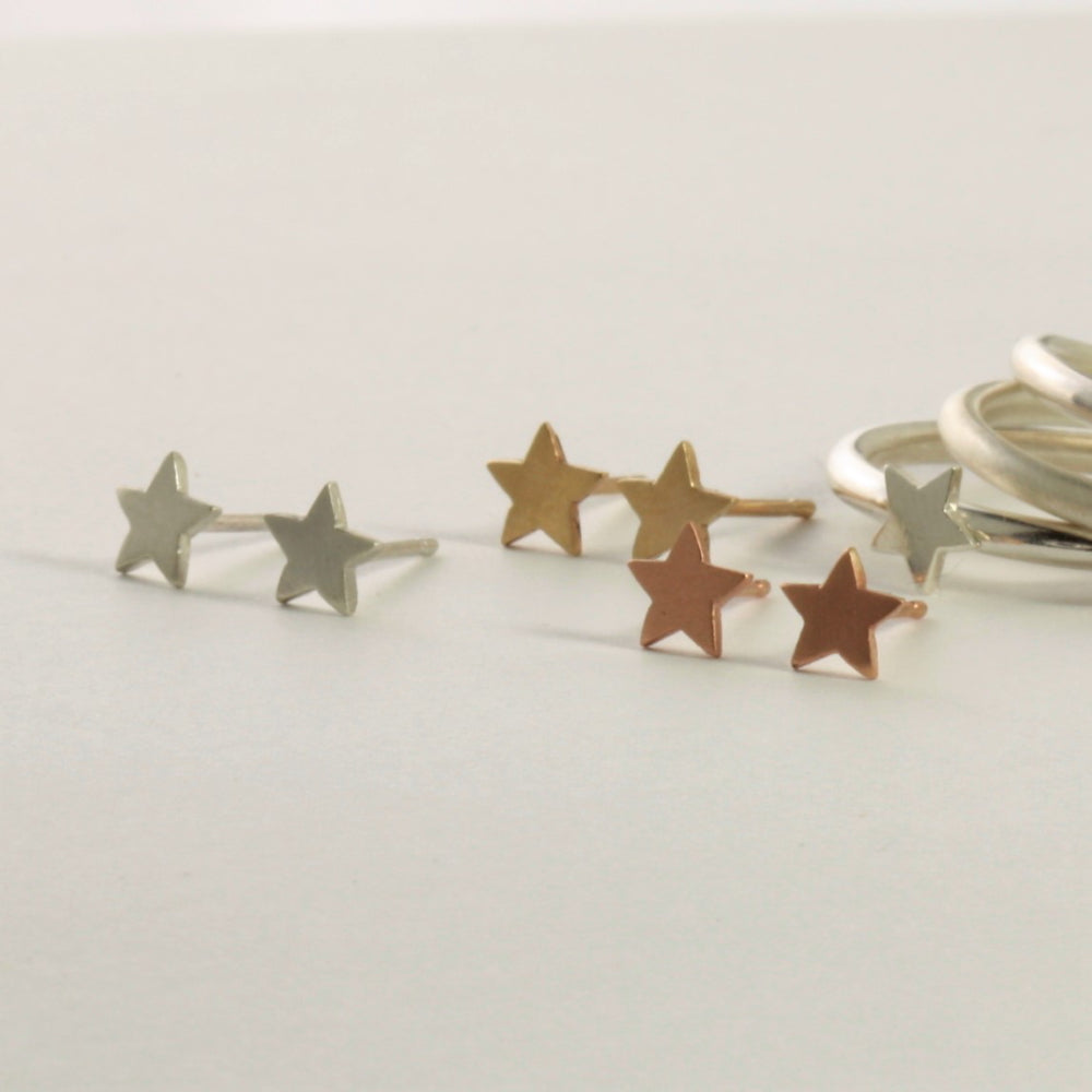 Handmade tiny gold and silver star earrings