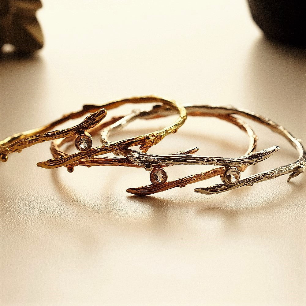 Handmade silver and gold twig topaz bangle