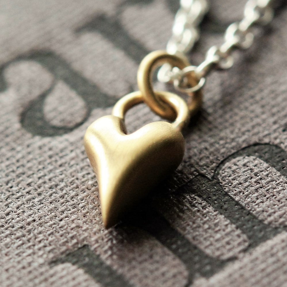 Gold heart pendant and sterling silver chain