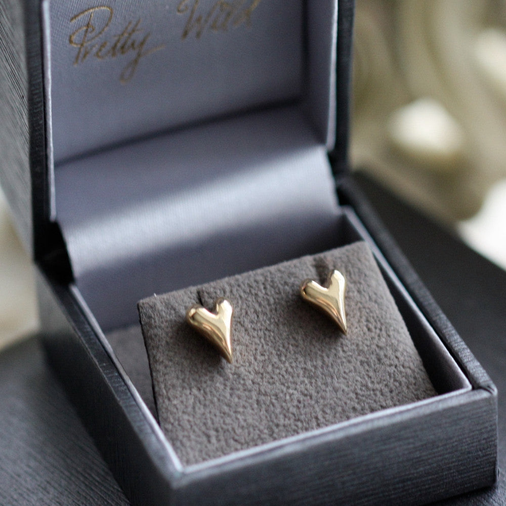 arts and crafts solid gold heart stud earrings in a branded luxury grey Pretty Wild jewellery presentation box