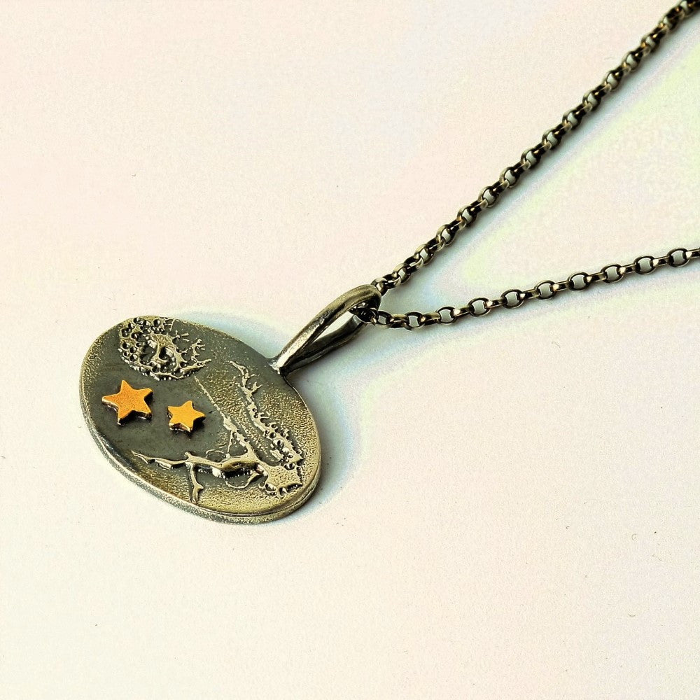 Unique fairy necklace holding on to her dandelion with added solid gold stars