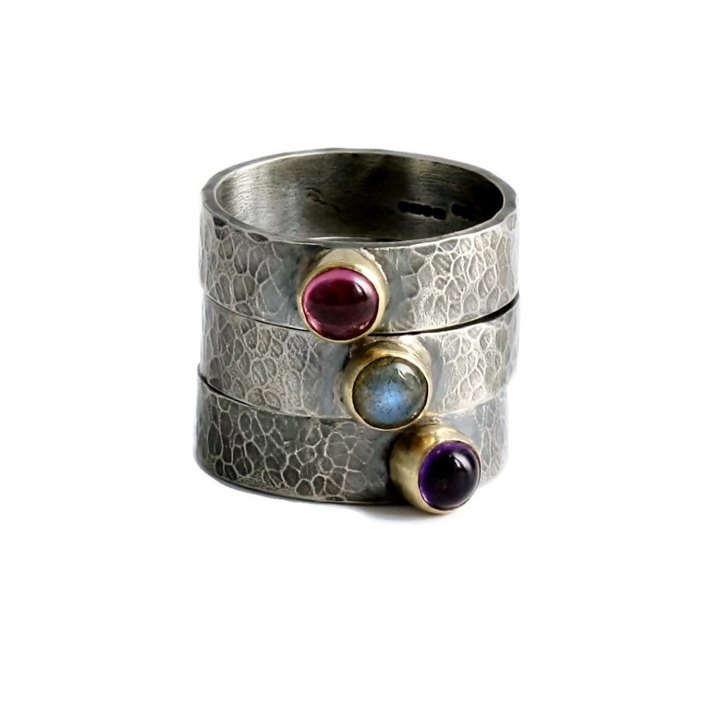 Wide silver and gold gemstone textured ring bands