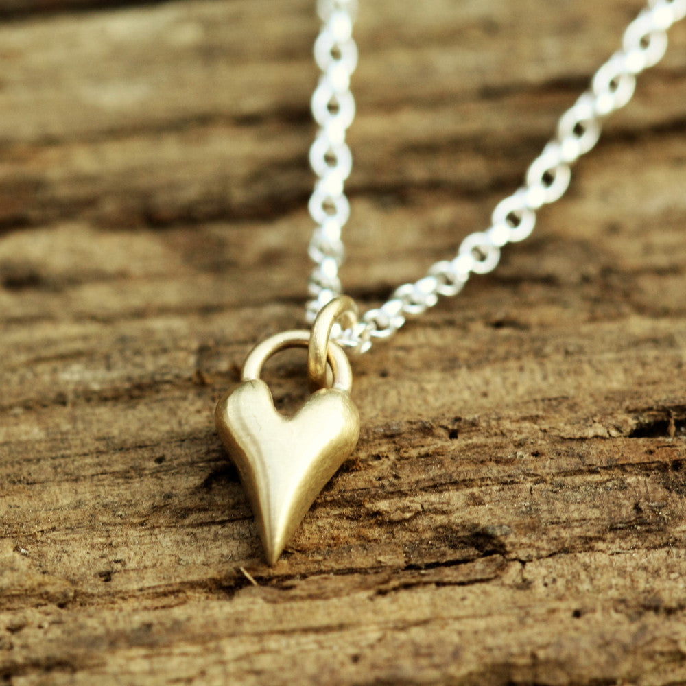 solid gold heart on a silver chain