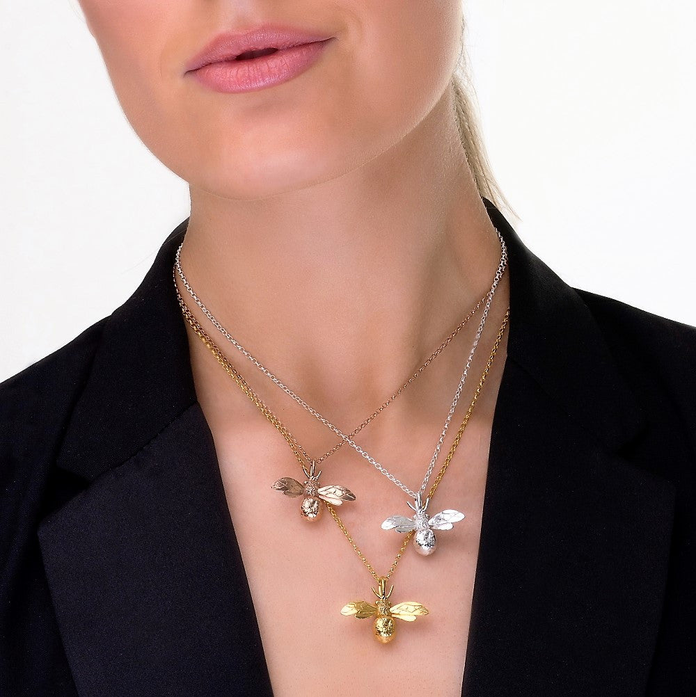 Model wearing sterling silver, rose gold and yellow gold gilded designer bumble bee necklace