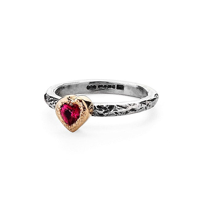 Pink Heart Tourmaline encased in a 9ct gold setting on a textured ring band