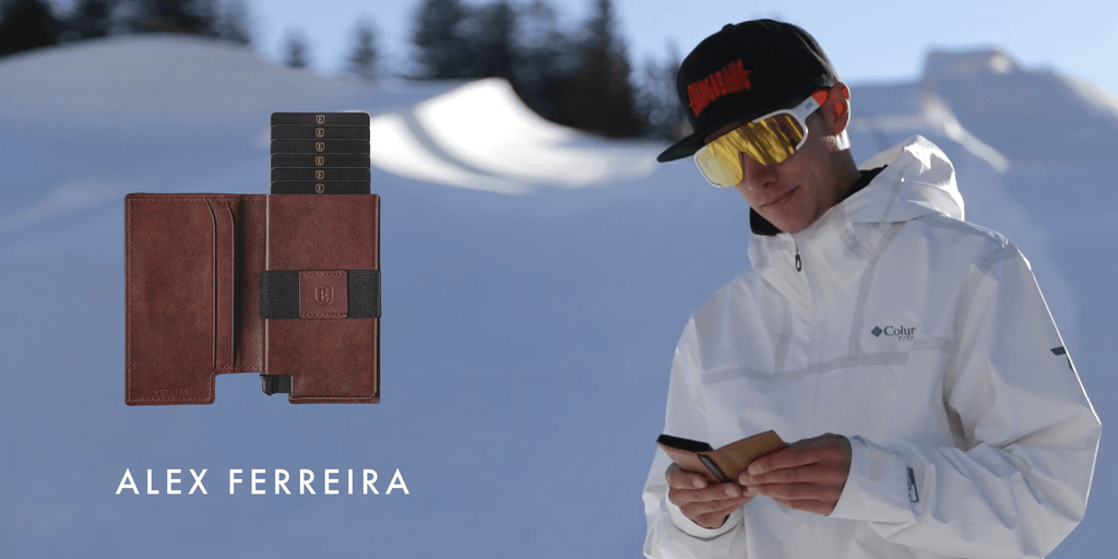 Image of Alex Ferreira using his smart wallet in the slopes, with an image of the tracker wallet superimposed next to him.