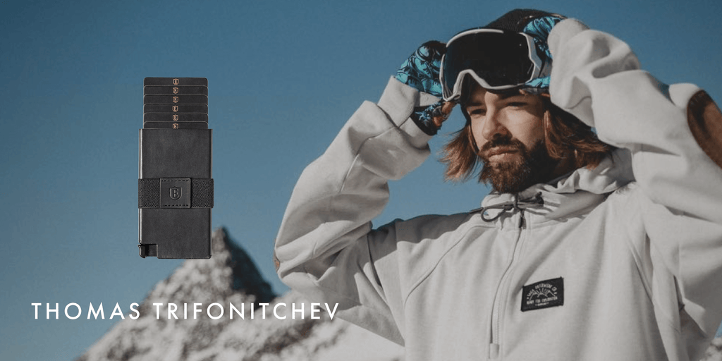 Image of Thomas Trifonitchev putting on a ski visor in the slopes, with an Ekster tracker wallet superimposed next to him.