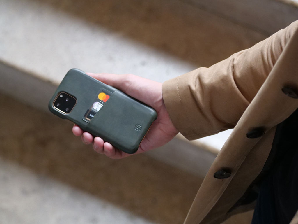 A man holding an iphone with a case
