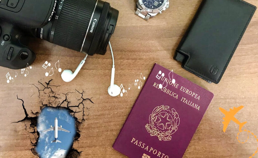 image of camera, earphones, passport and a handmade leather wallet