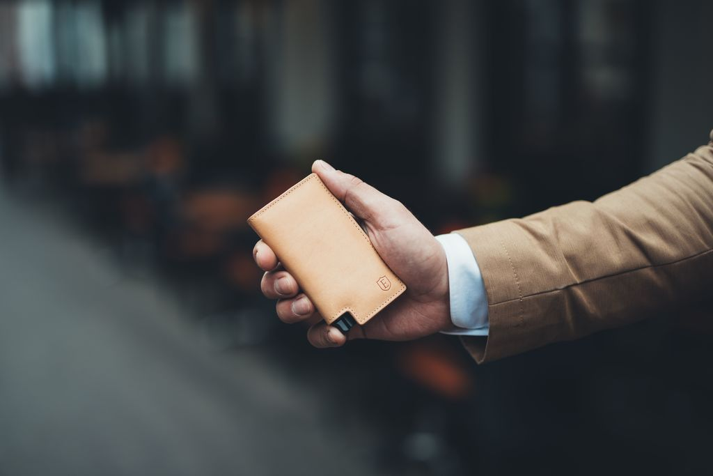 A man holding a wallet