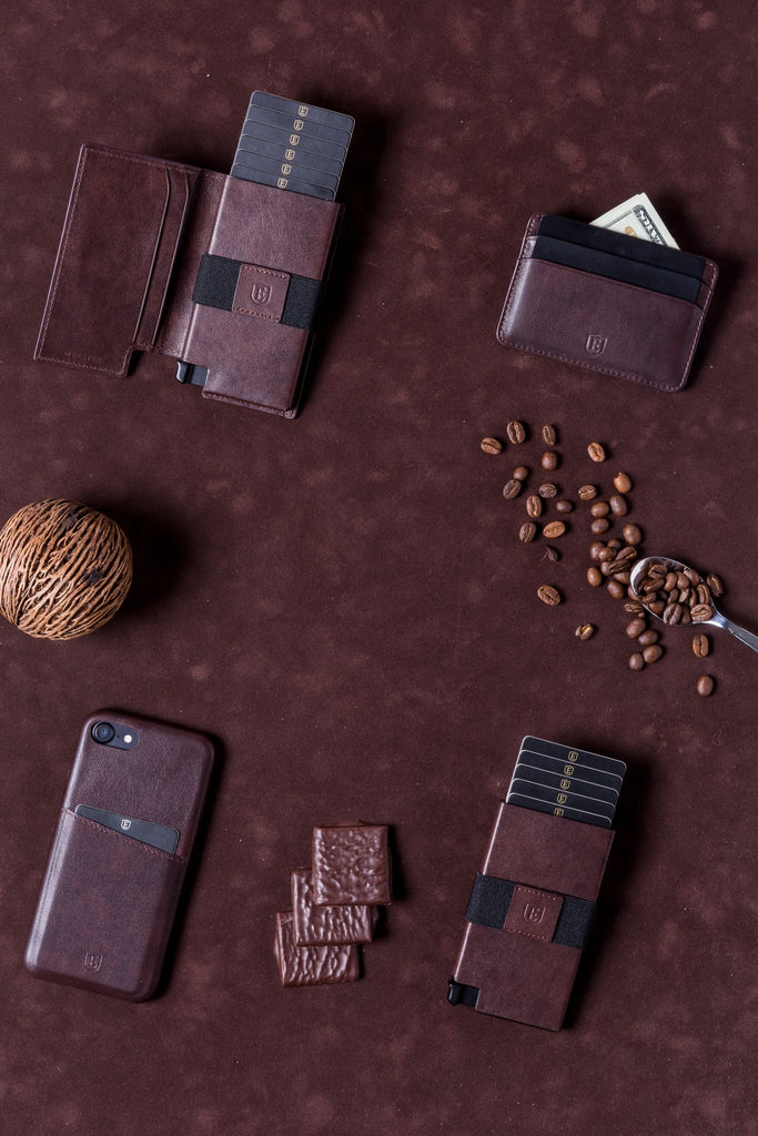 Card wallets on a table with coffee beans