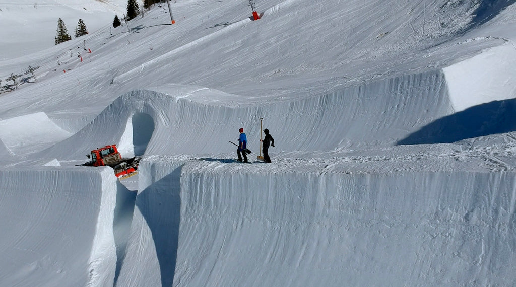 Image of a specialized machine clearing the slopes on which the shoot for this travel wallet took place.